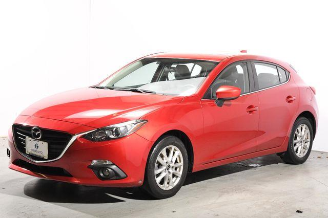 The 2015 Mazda Mazda3 i Grand Touring photos
