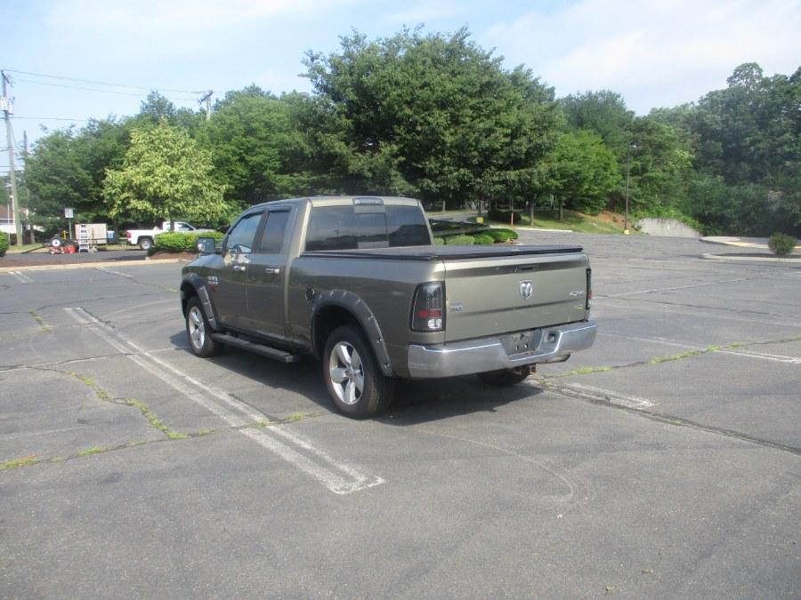 "Used Ram 1500 4WD Quad Cab 140.5"" SLT 2013   Universal Motors LLC. New Britain, Connecticut"